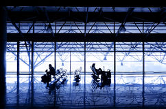 Silhouettes of people waiting at the boarding gates. Stock Image