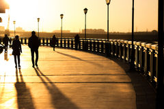 Silhouettes of people. Walking along the seafront promenade Royalty Free Stock Photography