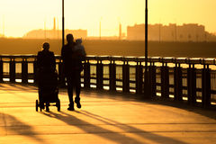 Silhouettes of people. Walking along the seafront promenade Stock Images