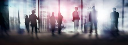 Silhouettes of people walking in the street near skyscrapers and modern office buildings. Multiple exposure blurred image. stock illustration