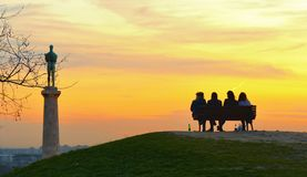 Silhouettes of people on warm colorful sunset in Belgrade, Serbia stock image