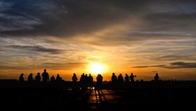 Silhouettes of people on warm colorful sunset on river Danube in Belgrade, Serbia. Silhouettes of people and warm colorful sunset on river Danube in Belgrade royalty free stock photos