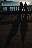 Silhouettes of people on the waterfront. Stock Photography