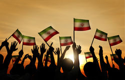 Silhouettes of People Waving the Flag of Iran Royalty Free Stock Photos