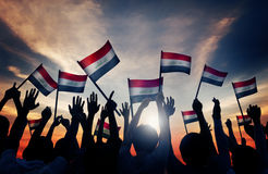 Silhouettes of People Waving the Flag of Iraq Stock Photography