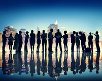 Silhouettes of People Working and Cityscape Royalty Free Stock Image
