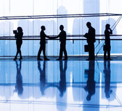 Silhouettes of People Working in an Office Building Royalty Free Stock Photography