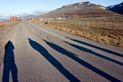 Silhouettes of Persons Walking on the Road Stock Photos