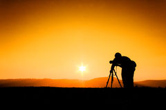 Silhouettes photographers Royalty Free Stock Images