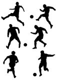 Silhouettes of player. S in football with a ball Stock Photos