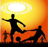 Silhouettes of players in soccer Stock Photo