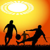 Silhouettes of players in soccer Stock Image