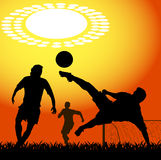 Silhouettes of players in soccer Stock Photography