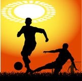 Silhouettes of players in soccer Royalty Free Stock Photography