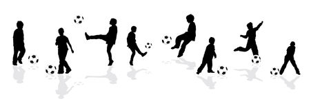 Silhouettes playing football Royalty Free Stock Image