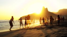 Silhouettes Playing Soccer Rio Brazil. Silhouettes playing soccer in double exposure overlay on Ipanema Beach in Rio de Janeiro, Brazil stock footage