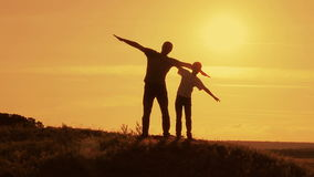 Silhouettes of the pope and his son at sunset stock footage