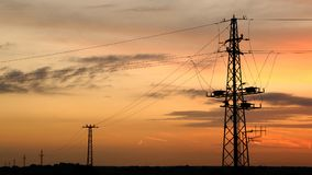 Silhouettes of Power Line. In sunset stock photos