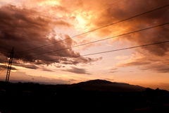 Silhouettes of the power lines Stock Photography