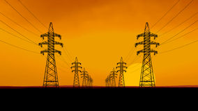 Silhouettes of power lines. Royalty Free Stock Photos
