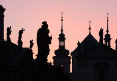 Silhouettes of Prague. Silhouettes of towers and figures on Charles Bridge in Prague, Czech Republic Stock Photos