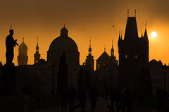Silhouettes of Prague towers and statues on Charles bridge durin Stock Images
