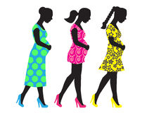 Silhouettes of pregnant woman Royalty Free Stock Photo