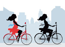 Silhouettes of pregnant women on the bike. City background. Illustration in vector format. Horizontal Stock Image