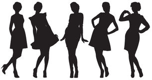 Silhouettes of pretty women. Five black silhouettes of pretty women Stock Photography