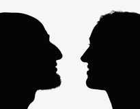 Silhouettes of profiles of man and woman;. A girl and a guy are looking at each other Stock Illustration