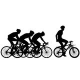 Silhouettes of racers on a bicycle, fight at the finish line Stock Images