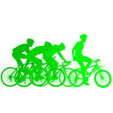 Silhouettes of racers on a bicycle, fight at the finish line Royalty Free Stock Image
