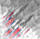 Silhouettes of rocket against the background of the flag of North Korea. Military background. Conflict in Asia. Silhouettes of rocket against the background of royalty free illustration