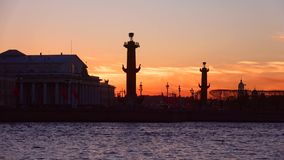 The silhouettes of the Rostral columns at sunset, evening Saint Petersburg stock video