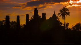 Silhouettes of the ruins of ancient temples at sunset. Thailand, Sukhothai stock video