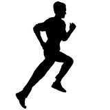 Silhouettes. Runners on sprint, men. Royalty Free Stock Photo