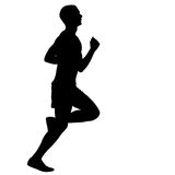 Silhouettes. Runners on sprint, men. Royalty Free Stock Photos