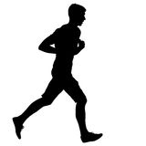 Silhouettes. Runners on sprint, men. Royalty Free Stock Photography