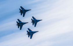 Silhouettes of russian fighter aircrafts in the sky Stock Photos