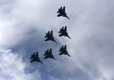 Silhouettes of russian fighter aircrafts in the sky stock images