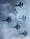Silhouettes of russian fighter aircrafts SU-27 in the sky Royalty Free Stock Photos