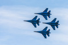 Silhouettes of russian fighter aircrafts SU-27 in the sky. Silhouettes of russian fighter aircrafts SU-27 in blue sky Royalty Free Stock Photo