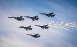 Silhouettes of russian fighter aircrafts SU-27 in the sky Stock Images
