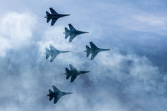 Silhouettes of russian fighter aircrafts SU-27 in the sky. Silhouettes of russian fighter aircrafts SU-27 in the blue sky Stock Photos