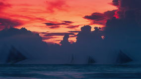 Silhouettes of sailboats on the background of clouds at sunset. 4K TimeLapse - August 2016, Boracay, Philippines stock video footage