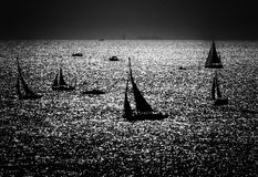 Silhouettes of the sailboats. A black and white shot of sailboats showing them just as silhouettes royalty free stock photography