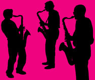 Silhouettes of sax players. Black silhouettes of saxophone players against magenta background Stock Photo