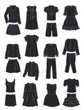 Silhouettes of school clothes for girls Stock Images