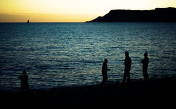 Silhouettes by Sea Royalty Free Stock Image
