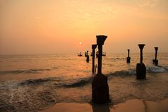 Silhouettes of sea piers. During the sunset in Calicut, India stock photo